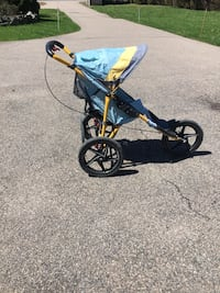 baby's black and yellow jogging stroller Lincoln, 02865