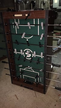 Brown and green foosball table Philadelphia, 19135