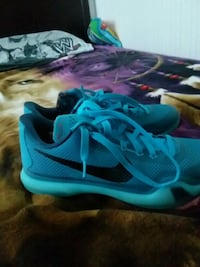 pair of teal-and-black Nike running shoes Ronkonkoma, 11779