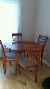 Solid table with 4 chairs. Comes with extension
