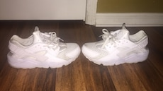 pair of white Nike Huarache