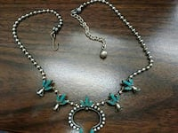 silver and blue pendant necklace