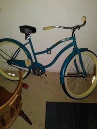 blue and white cruiser bike