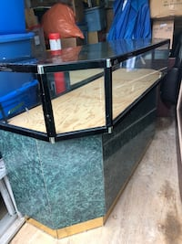 Glass and wood display case with shelves. Measures 5 feet by 22 inches by 38 inches high White Rock, V4B 2B9