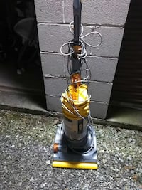 yellow and black upright vacuum cleaner 584 mi