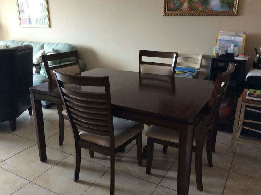 rectangular black wooden table with four chairs dininig set