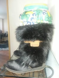 pair of black suede mid-calf mukluk boots