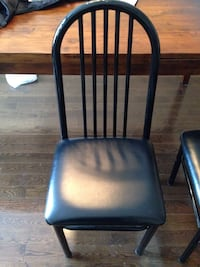 black metal framed black leather padded chair