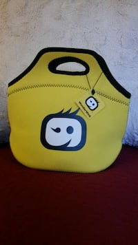 yellow, black, and white lunch bag