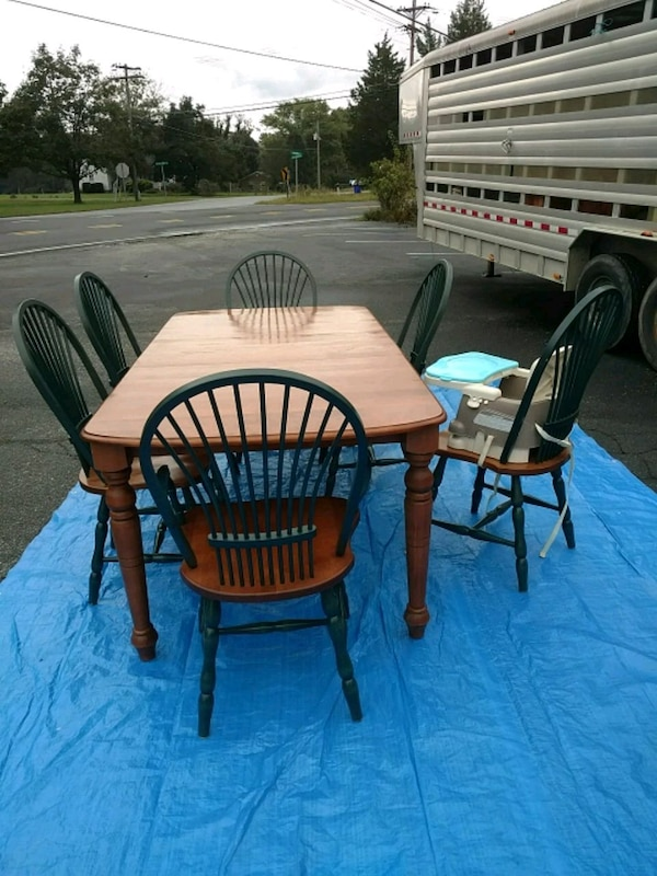 oval brown wooden table with four chairs dining se