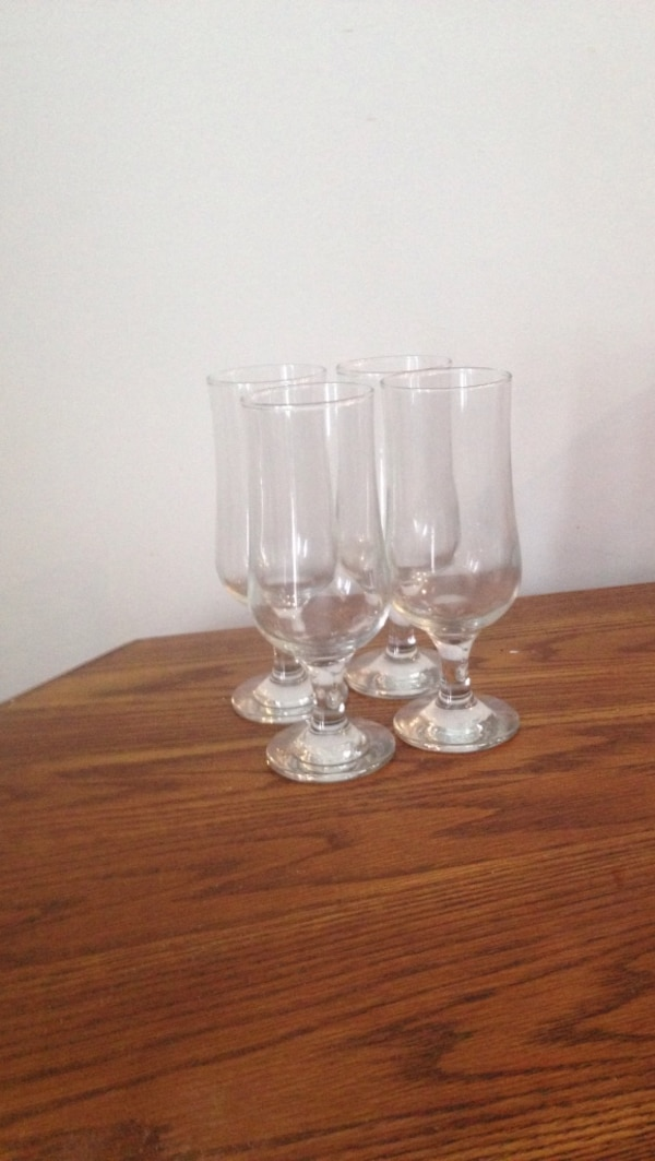 four footed clear glasses