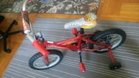 children's red and black bicycle