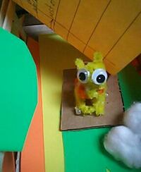 yellow monster toy/cat