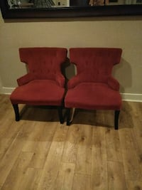 Red chairs with brass studded design on back. Lodi, 95240