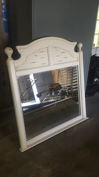 white wooden framed wall mirror