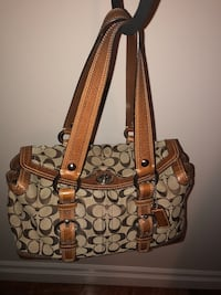 Authentic Coach bag. Brown/tan signature logo material with brown leather trim   Surrey, V3S 5V4