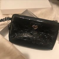 women's black Coach leather wristlet