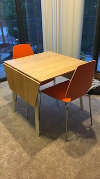 Expandable brown wooden table with chairs