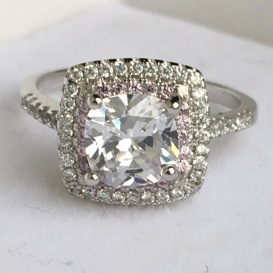 Size 8 three carat cushion cut halo sim. diamond ring