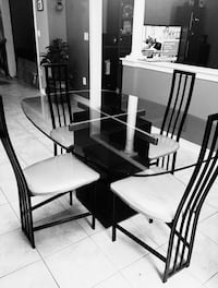 black metal framed glass-top table with chairs Brampton, L6V 1E8