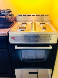 Stainless Steel and black gas range oven