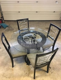 round black wooden table with four chairs dining set El Paso, 79938