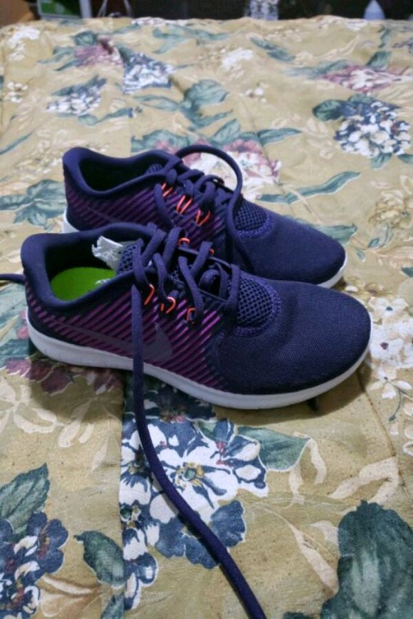 pair of purple-and-black Adidas running shoes
