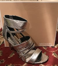 unpaired silver-colored Michael Kors leather open toe ankle strap heels with box
