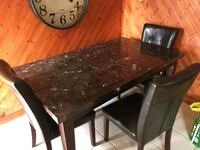 rectangular brown wooden table with four chairs dining set Niagara Falls, L2E 1Y6