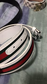 white, red, and green Gucci leather belt
