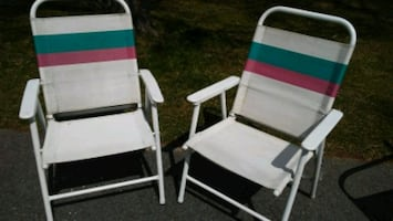 Pair of vintage metal folding patio chairs