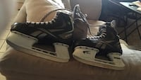 Pair of Reebok pump youth black and gray ice skates( size 4)