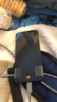 Black I phone 5 16 g! Needs tlc. Phone works but I have to tape a portion of the lower half Anchorage, 99502