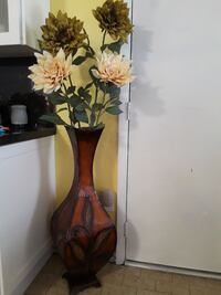 brown flower vase with brown and white Dahlia flowers