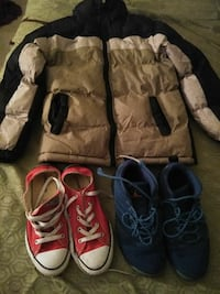 pair of blue Air Jordan basketball shoes; pair of red Converse All Star low tops and brown and black zip-up jacket