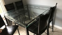 rectangular glass top table with four chairs dining set Centre Wellington, N1M 3L5