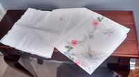 Small square white embroidered tablecloth with 4 napkins.   Mississauga