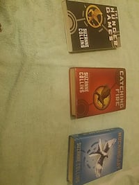 three Catching Fire novel books by Suzanne Collins