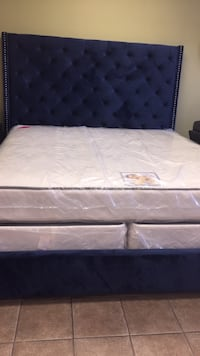 white mattress with black wooden bed frame