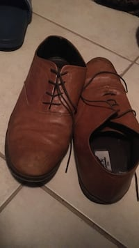 pair of brown leather lace-up shoes