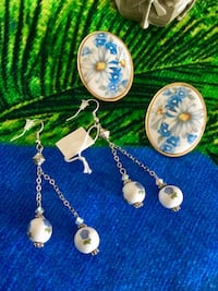 Classy and sophisticate earrings / Long silver earrings $25 / Oval -floral ceramic earrings $25   Alexandria, 22311