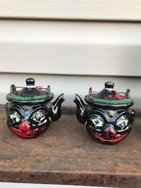 Two black and red ceramic tea pot