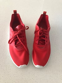 Pair of red adidas low-top sneakers Montreal, H3G 1M8