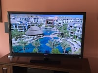 black flat screen TV with remote Southport, 28461