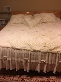 Bed spread with 3 pillow covers and one matching curtain . The bedspread is handmade Ridgefield, 07657