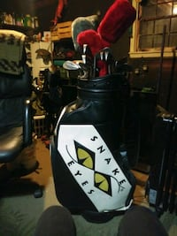 Snake eyes golf bag, with assorted clubs