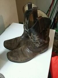 pair of black leather cowboy boots College Station, 77840