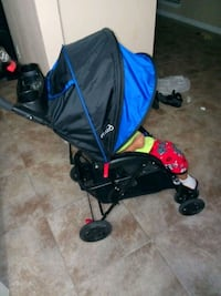baby's blue and black stroller Conroe, 77385