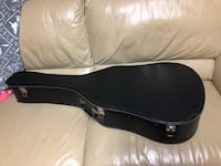 Full size acoustic guitar case.  All clasps work  London, N5Y 4A6
