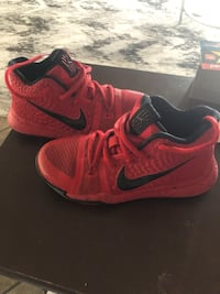 pair of red-and-black Nike running shoes Albuquerque, 87121